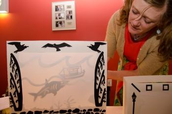 Allison Villani demonstrates shadow puppet theater