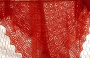 Red knitted lace shawl.