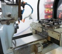 Closeup of inside the robot-ish lathe.