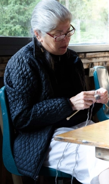 a knitter prepares
