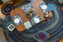Another beautiful braided rug under the kitchen table.