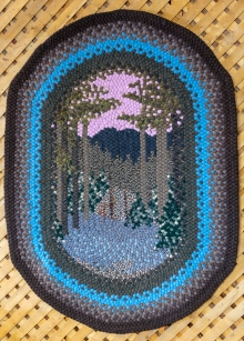 This rug was made by another woman and shows a wooded scene.