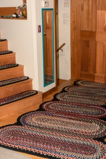 Nancy custom designed and braided these concentric oval rugs to fit her hallway.
