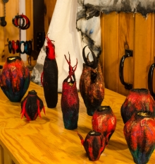 red and black felted vessels